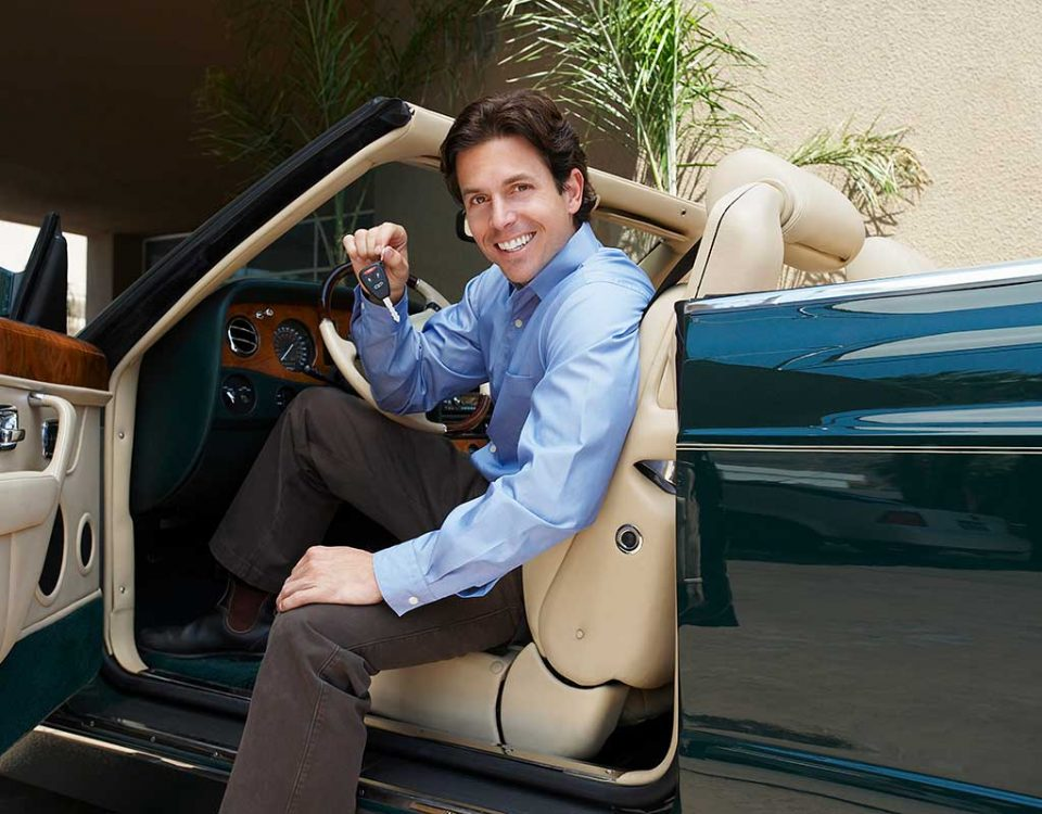A Man Holding a Car Key